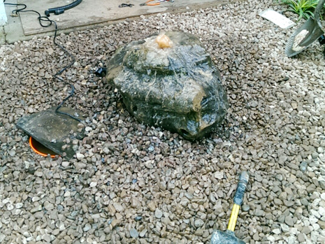 installing bubbling boulders, water feature